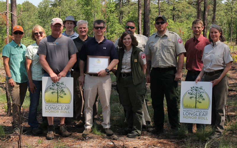 Photo of Ed Mar Farms recieving Longleaf Honor Roll Award