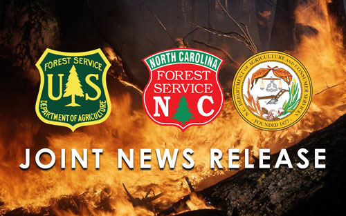 Photo of wildfire at night with logos of USDA Forest Service, N.C. Forest Service, and N.C. Department of Agriculture and Consumer Services